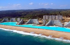 14 Of The Most Phenomenal Pools In Existence.  This one is the San Alfonso del Mar Seawater Pool in Algarrobo, Chile. It is 1 kilometer (0.62 miles) long, covers 20 acres, and contains 66 million gallons of water!