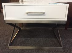 Mid century style with stainless base. Retails for $$234. Our price $117