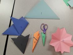make a 9 pointed star: 1. Square piece of paper, fold diagonally 2-3. Fold into thirds with crease at the bottom point 4. Fold into thirds again! 5. Cut at an angle 6. Unfold and ta-daa!!