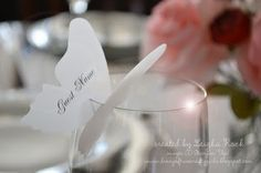 Butterfly Wine Glass Place Cards by Leigha Rock.  This is so creative and I bet the whole room looked beautiful with these on the tables.
