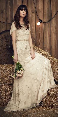 99c18ef56a5be2 Jenny Packham Spring 2017 Blossom wedding dress in beige with sequin-lined  sleeves and neckline and clinched waist