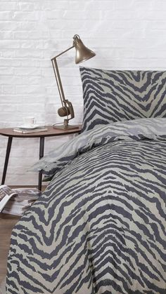 Add some flare to your bedroom with the Simba duvet set. The set features a stylish animal print in natural tones. The cover can be reversed, featuring the same tiger print pattern in more muted tones. Perfect for any stylish bedroom.