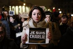 "A woman holds a placard that reads, ""I am Charlie"", during a vigil to pay tribute to the victims of a shooting by gunmen at the offices of weekly satirical magazine Charlie Hebdo in Paris, at Trafalgar Square in London January 7, 2015. (Photo by Stefan Wermuth/Reuters)"