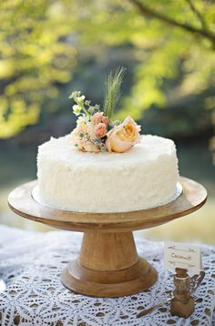 simple cake on a wooden stand   Paperlily Photography #wedding