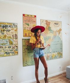 Blue jean shorts with yellow tshirt, red hat, maps