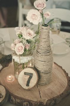 Love the use of barked planks of wood for the table number and centerpiece base... and the twine adds a lovely touch lol