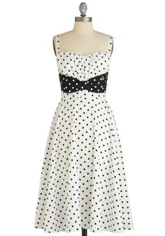 Humbly Haute Dress By Stop Staring!  While the sleek fashion future is always on your radar, you are still a fan of the stylish days of yore, when retro-fabulous frocks like this black and white A-line by Stop Staring! ruled the world of popular fashion. Its modest length and giddy dots are irresistibly adorable, while its bowed sash and ruched top are undeniably stylish.  $189.99