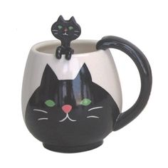 {Cat Round Mug & Spoon Set} that little kitty sitting on the rim? that's the spoon!