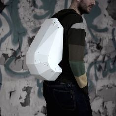 Give yourself a sci-fi like adventurous look by carrying your everyday necessities including laptops in this beautifully designed White – Black #Backpack by Solid Gray.