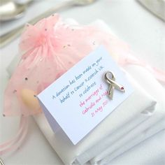 traditional sugared almonds to guests that had been bought online, as well as breast cancer pin badges to represent the donation the newlyweds had made on behalf of their wedding guests.