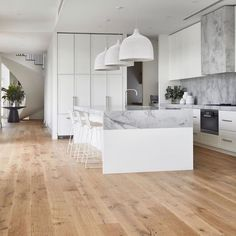 Light and airy white modern kitchen with white oak flooring and spiral staircase. Decor Style Home Decor Style Decor Tips Maintenance Apartment Decoration, Decoration Bedroom, Timber Flooring, Formal Living Rooms, Modern Kitchen Design, Home Kitchens, Beach Kitchens, New Homes, House Design
