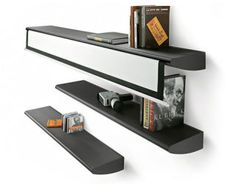 Now, here's a great idea: Why not disguise a projection screen as a bookshelf, and then place a few other identical-looking shelves nearby as decoys? That's just what Italian designer Matteo Ragni has dreamed up here, trying to cross that bridge between a dedicated home theater room and a multi-use space that might double as a reading room, too. The only problem we see? If this is going to be a big enough screen, it's going to amount to one tremendously long shelf. This example is 170…
