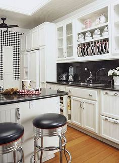 Imagine yourself in this throwback kitchen with vintage-style accessories and checkered walls #retrokitchen