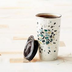 Starbucks Metallic Fleck, 12 fl oz Double Wall Traveler   A double-walled ceramic mug with a beautiful speckled design. Part of our Dot Collection.   Beautiful flecks of color and shine coalesce to form a dot in this Dot Collection coffee mug.   $19.95