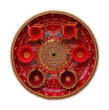 Now, change your way of worship with this diwali hand painted pooja thali with dazzling look and will definitely appear more sparkling after placing diyas. This thali is made of brass and it's a complete handmade item decorated with green kundan and sorrounded by mirror making it more alluring. You can also present this thali as a gift specially on diwali occasion or any other fest.  This Diwali special combo set offer you 1 Decorated Pooja Thali and 6 Diya.