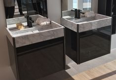 Natural stone carrara  marble basins by L'antic Colonial of Porcelanosa.