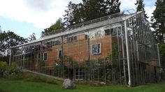 Couple in Sweden surrounds eco-home with greenhouse to keep it warm | It's an innovative, out-of-the-box and under-the-greenhouse idea that not only keeps the house warm, but also protects it from weathering due to the elements. It would not work in extremely hot and sunny climates, but for the colder, northern climates it may be a viable alternative to cut heating bills and to extend your growing season. More over at Fair Companies and Ecosol.