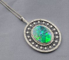 Art Deco Platinum, Black Opal, and Diamond Pendant, bezel-set with a black opal measuring approx. 21.80 x 17.15 x 4.80 mm, framed by old mine and rose-cut diamonds, suspended from a delicate platinum chain, lg. 2 and 28 in.