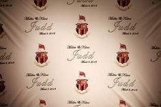 Red carpet wall with wedding date, couples names and family crest