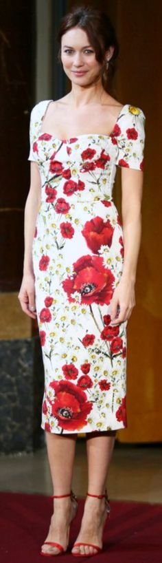 Who made Olga Kurylenko's red and white floral dress?