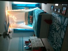 The final result of Lilly's room. Aqua blue stripes in three shades. String lights behind sheer curtains hanging from the ceiling. Red accent (including a red ceramic cat). We still haven't hung pictures on the wall, but she loves it!