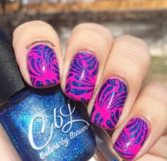 Colors by llarowe Stamping Polish - Royalty stamped over Orly Risky Behavior by @camonamona on Instagram.