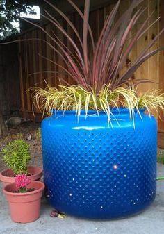 Washing Machine Drum Planter, Awesome Washing Machine Drum Ideas, http://hative.com/awesome-washing-machine-drum-ideas/,