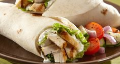 Tender strips of marinated chicken and chopped Romaine wrapped in a flour tortilla with a creamy garlic dressing.