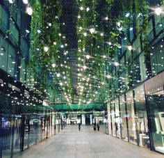 Shopping centre in Munich. Really like the lighting glow and vines combined.