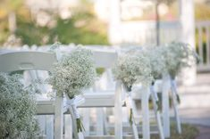 Loving the baby's breath clusters as aisle décor... could be easily re-purposed as cocktail hour décor- when placed in a mason jar ~ Iza