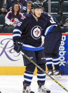 a4201ebccf0 WINNIPEG, MB - MARCH 1: Marko Dano #56 of the Winnipeg Jets takes