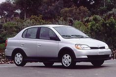 Toyota Echo Sedan. such a cute, tough little subcompact car. great for parking. 40+ mpg. surprisingly roomy and great storage.