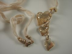 Swarovski hearts and gold-filled findings on silk ribbon necklace by Marcia Etheridge