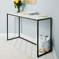 Box Frame Console - Marble. Antique bronze steel frame. 122W x 41D x 75.5H. $699 West Elm