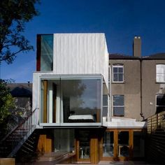 """Residential Architecture: Matilde House by Ailtireacht Architects: """"..an extension to a Victorian terrace house in Rathgar, Dublin..Constructed from light-grey zinc, the two-storey building houses an additional bathroom, bedroom and space for working..A new staircase on the exterior of the building joins the main living area and the back garden..A canopy built across an existing passage encloses the dining area.."""" Lightwells, extensive glazing, natural light; zinc cladding, interesting…"""