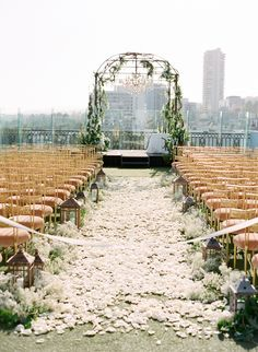 White rose petals blanketing the #aisle Photography: Jose Villa Photography - josevillablog.com