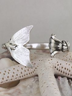 This amazing piece is a elegant Mermaid tail cuff bracelet handmade from a sterling silver spoon. The spoon was made from a company called Wallace
