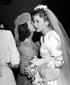 Olivia de Havilland and Joan Fontaine at Joan's wedding to Brian Aherne