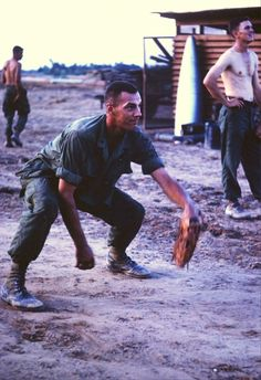 A soldier plays catch at the 9th Infantry Division base camp in 1967. The soldier wears second pattern boots as well. Photo taken by Stephen F. Hanold, who spend the first half of his tour with B Co 3/47 9th Division and second with HHC 2/8 4th Div. B Company, 3rd Battalion, 47th Infantry Regiment, 9th Infantry Division.