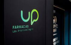 Signage for Up farmacias designed by Conca & Marzal.