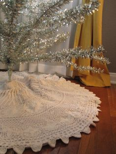 Vintage crochet christmas tree skirt - I've always wanted to do something like this but it looks like it would take forever to finish.