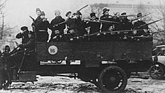 1917;  Russian Revolution - Bolshevik Red Guards patrolling on a truck at the Winter Palace in Petrograd