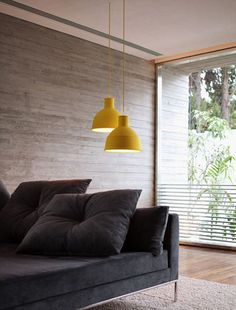 Yellow lamp hanging from the ceiling