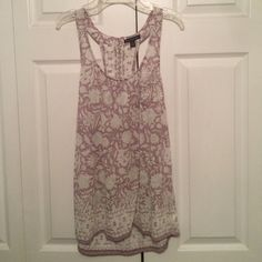 American Eagle Tank Top Some sign of wear but great condition! There is a front pocket on the left side. American Eagle Outfitters Tops Blouses