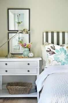 Striped headboard with florals. Love!