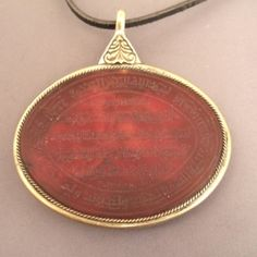Silver, gilded, carnelian intaglio, Afghanistan Description A beautiful pendant from Kabul adorned with a carnelian with Koranic writtings and also a beautiful engraving on the back of the jewel ...