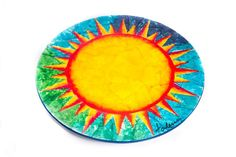 THE SUN ON YOUR TABLE Bring the light and warmth of the Sun to your kitchen or table with this beautiful wooden trivet, painted with a unique design