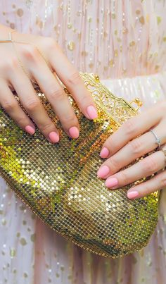 Blush nails and gold accessories are a perfect pair. ==