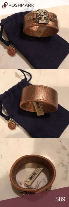"Tory Burch Skinny Logo Double Snap Cuff Rose Gold New with tags - Tory Burch rose gold leather double snap skinny logo bracelet.  Dust bag included.  Silver tone hardware  Rose gold leather  Bracelet width is 1""  Fits my wrist almost perfectly at approximately 6"" Tory Burch Jewelry Bracelets"