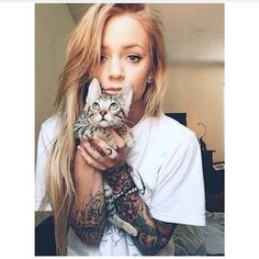 And finally, not only does this lady have some rad tattoos, but she also has a adorable kitten to go with them. | 31 Gorgeous Tattooed Women Who Will Make You Want To Get A Sleeve